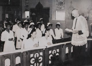 Photo Album with Images of Students At the First Catholic Nursing School to Accept African American Students.